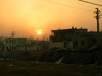 We arrived in Kuqa just before sunset. I took this photo from the bridge that connects New Kuqa to Old Kuqa.