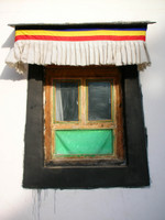 A typical feature of Tibetan architecture is the trapezoidal window frame.