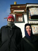 Chris and Rachel pose in the cold in front of Labrang's main temple.