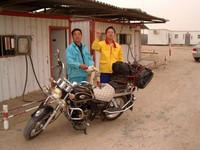 "The only gas station for 250+ km in either direction is at Tazhong (which literally means ""middle of the Taklamakan""). I was their first foreign customer. Fill 'er up!"