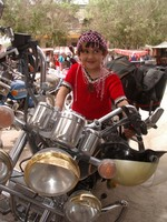 I managed to convince this cute little Uyghur girl to climb up on my motorcycle for a photo.