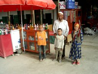 I stopped for an ice-cold drink and this man encouraged me to take a photo of him with some local children.