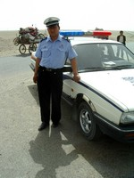 I was stopped by the police between Keriya and Hotan, but after showing them my passport and NJ driver's license they let me keep going. One officer even let me snap a photo.