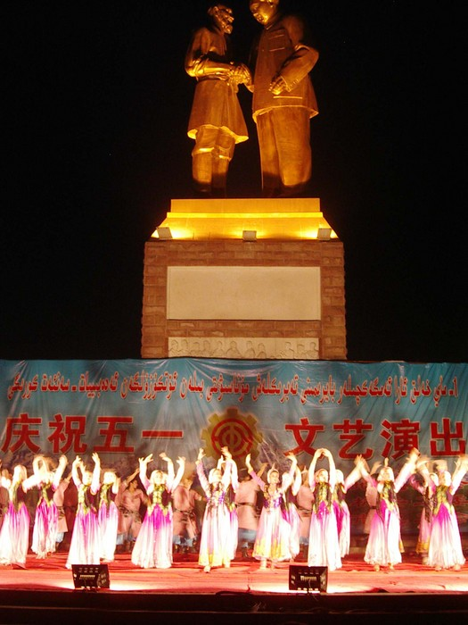 Shake your booty! A big Uyghur song-and-dance show under the watchful eye of Mao.