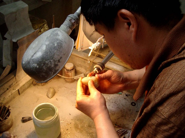Hotan's jade is the most famous in China. Inside many of the city's jade shops, you can see the stones being beautifully carved.
