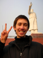 """Typical Chinese photo-pose"" Chris in front of Chengdu's huge statue of Mao."