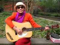 This rockin' old woman was happily strumming away in a park at Wuhou Temple. Unfortunately, her strumming was just that... I don't think she could even play a single chord.