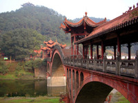 A bridge connecting two small islands near the Leshan Giant Buddha.