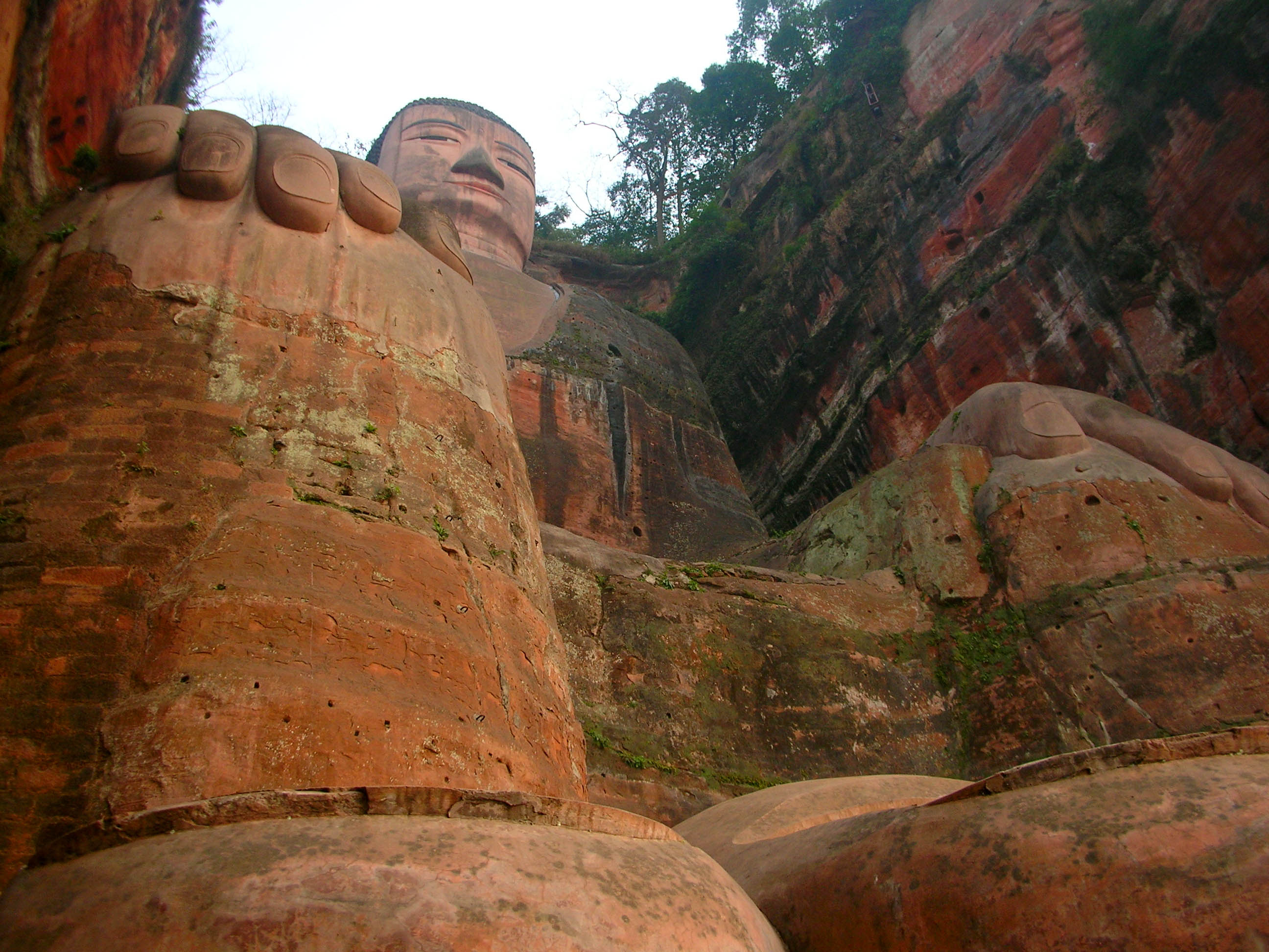 Looking up from below at the Leshan Giant Buddha. Those two objects at the very bottom of the photo are (L to R) the Buddha's right foot's fourth and third toes (with toenails).