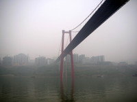 Passing under one of the fancy, modern bridges that the Chinese have constructed over the Yangzi in the past few years.