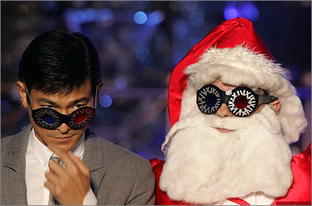 Hong Kong actor Andy Lau and a man in Santa Claus costume wear 3D spectacles at a Christmas lighting ceremony outside a shopping mall in Hong Kong.