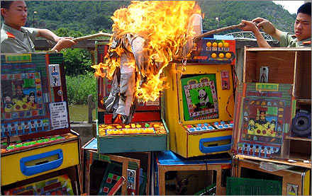 Illegal gambling machines being burned by Chinese police.