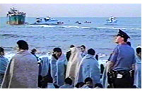 The Golden Venture, filled with illegal Chinese immigrants, ran ashore off of Queens, New York on June 6, 1993.