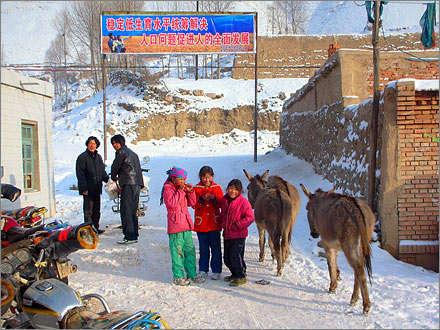A population control banner in a Tibetan village in Qinghai province.