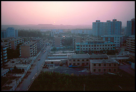 Patrick Jennings' photo taken from the Bayinguoleng Hotel, looking east at sunrise in September 1998.