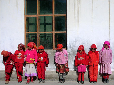 Ethnically Kyrgyz schoolgirls living in a small village along the road between China and Pakistan, outside their small schoolhouse.