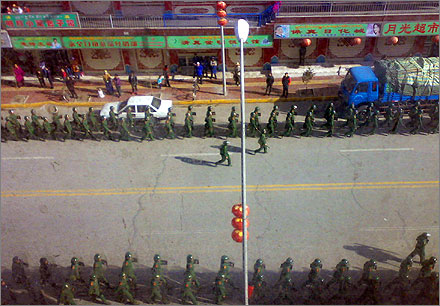Chinese troops march on the streets near Labr@ng Monastery in Xi@he, Gansu province.