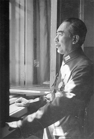 Governor Sheng Shih-Tsai looking out window.