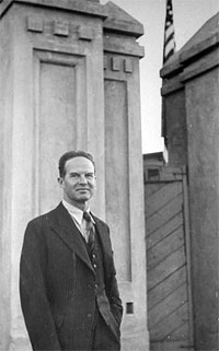 US Consul Edmund Clubb standing outside building.