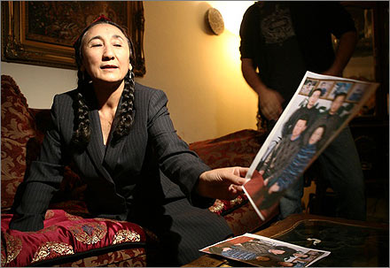 Rebiya Kadeer shows a photo of her children.