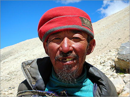 A Tibetan yak herder. He made me give him some potatoes and a chicken sausage to take this photo.