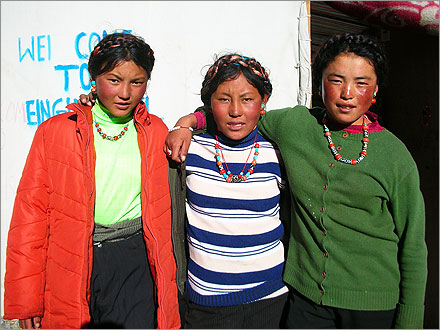 Three eligible teenage Tibetan girls, all of whom work at Everest Base Camp.