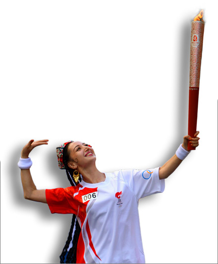A Uyghur woman performs a traditional dance while carrying the Olympic torch. Urumqi, June 18, 2008.