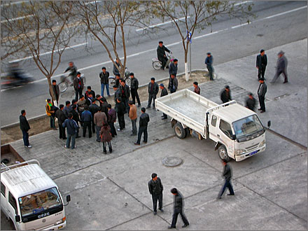 Uyghurs arguing on the street in front of my apartment. 2005.