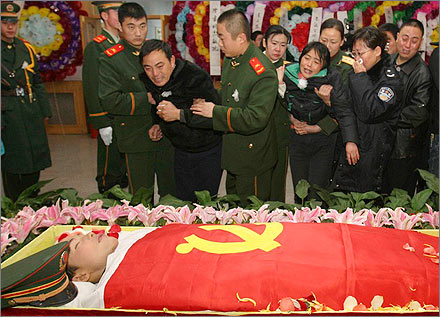 Funeral for policeman killed in a raid on a Uyghur seperatist camp in Xinjiang.